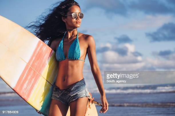 beautiful woman surfer - asian swimsuit models stock photos and pictures