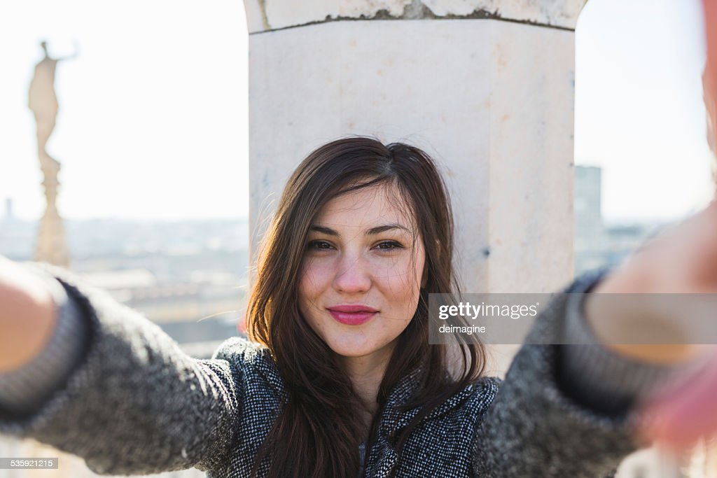 Beautiful woman takes a selfie : Stock Photo