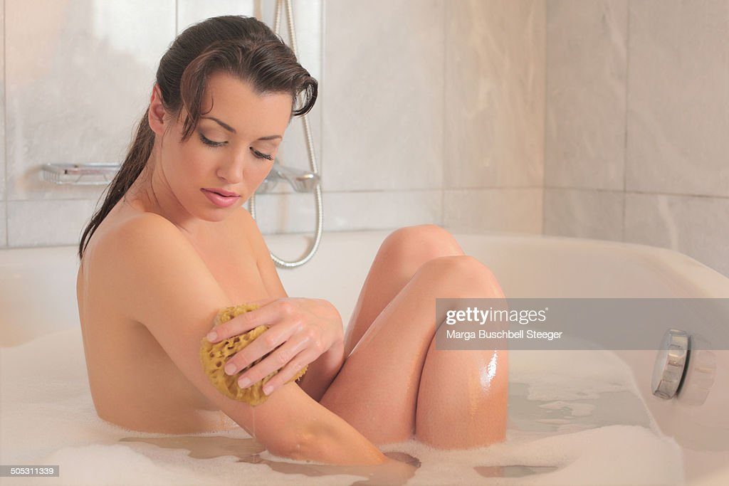 Woman in the bathroom shows her body for the community