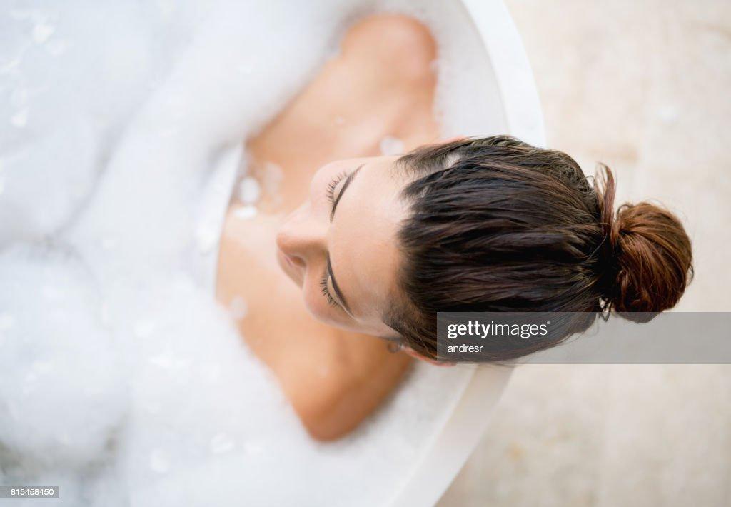 Beautiful woman taking a bath : Stock Photo