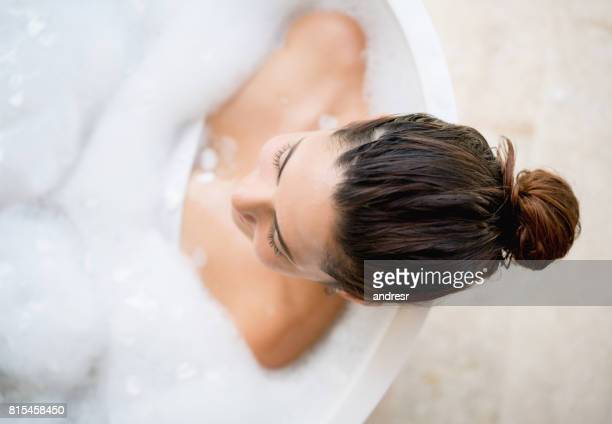 beautiful woman taking a bath - taking a bath stock pictures, royalty-free photos & images