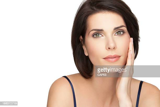 beautiful woman taking care of her skin - beautiful women stock pictures, royalty-free photos & images