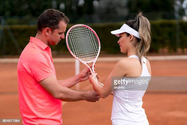 Beautiful woman taking tennis lessons
