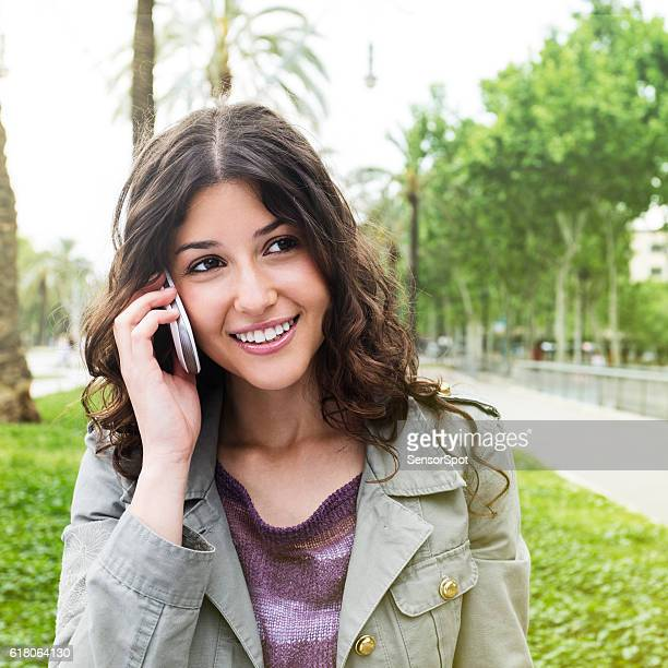 beautiful woman talking using a smartphone - western europe stock pictures, royalty-free photos & images