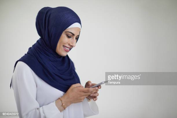 Beautiful woman texting on a smart phone.
