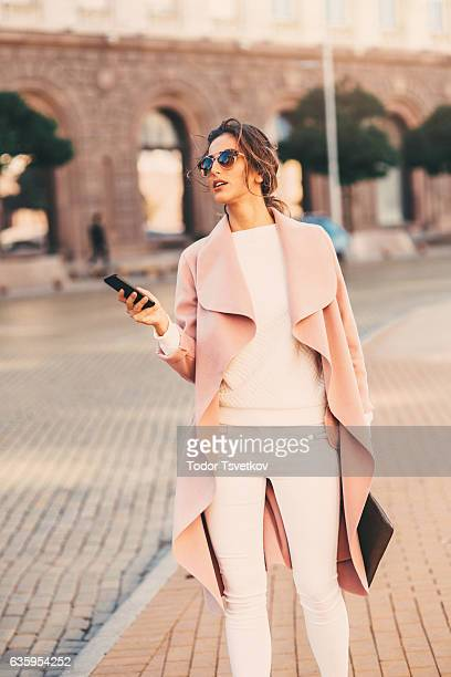 Beautiful woman texting on the phone