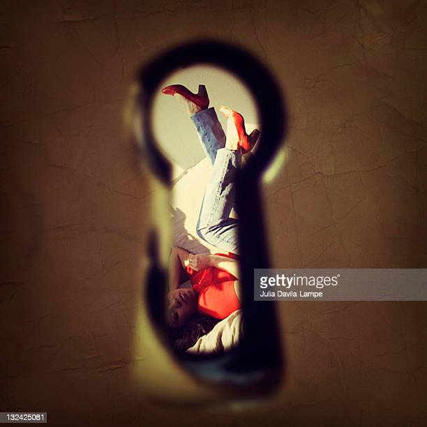 beautiful woman through keyhole - lech stock photos and pictures
