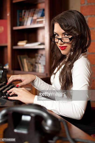 beautiful woman typing on the old typewriter - secretary stock photos and pictures