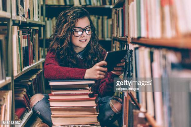 beautiful woman using tablet - literature stock photos and pictures