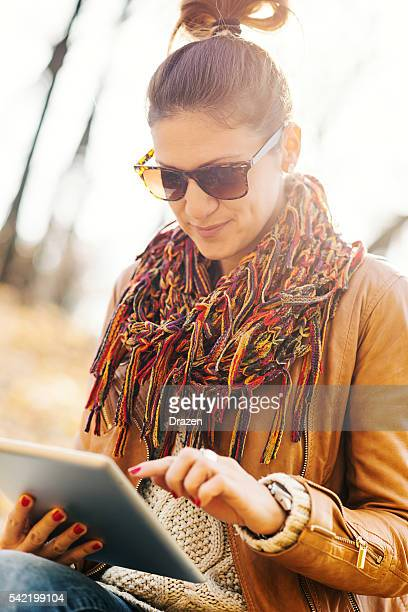 Beautiful woman using technologies outdoors