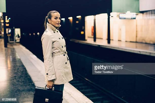Beautiful woman waiting in the metro
