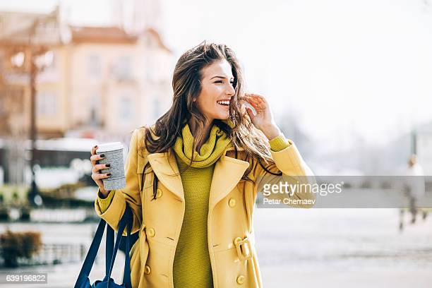 beautiful woman walking outdoors on a sunny day - a fall from grace stock pictures, royalty-free photos & images