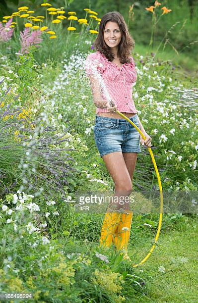 Beautiful Woman watering the Flower Garden (XXXL)