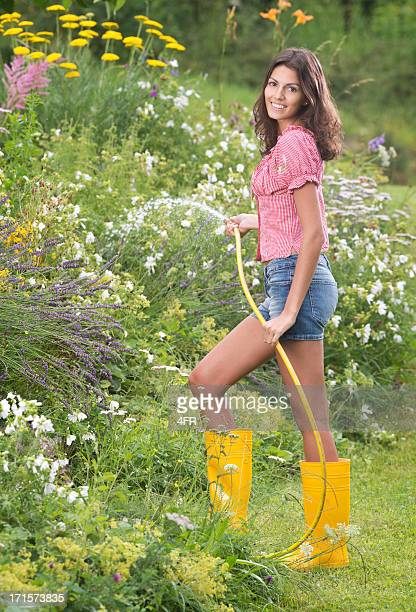 Beautiful Woman watering the Flower Garden (XXXL)