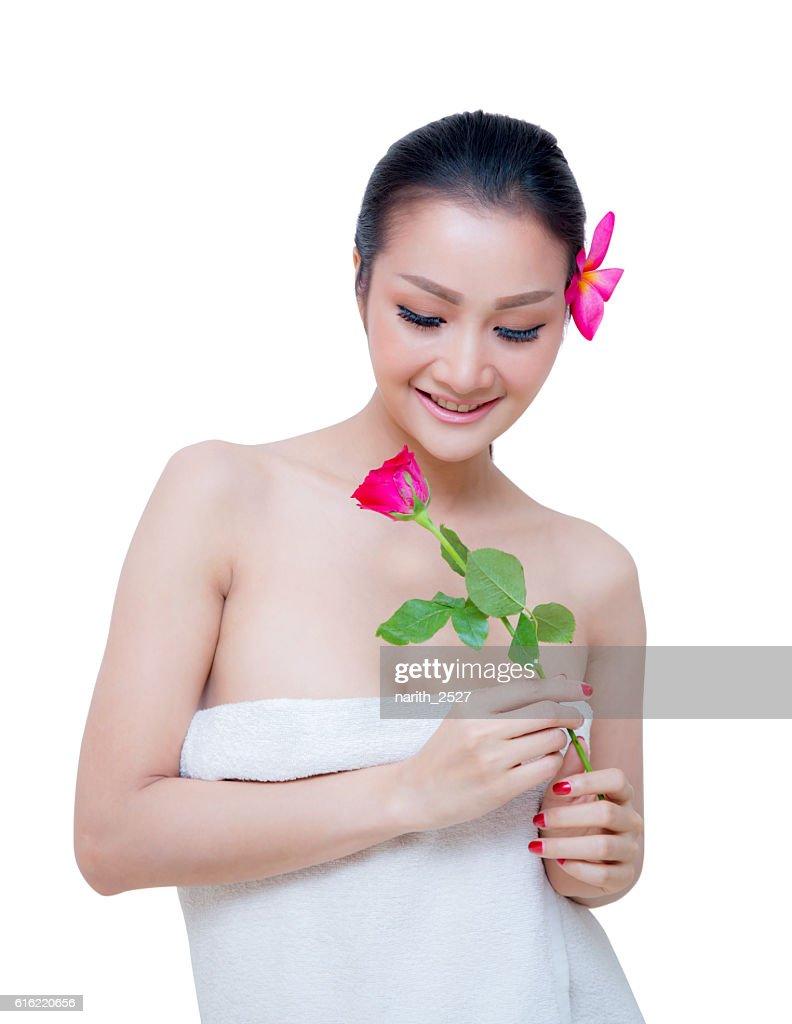 beautiful woman wear towel hold rose flower : Stock Photo