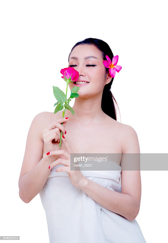 beautiful woman wear towel hold rose flower : Bildbanksbilder