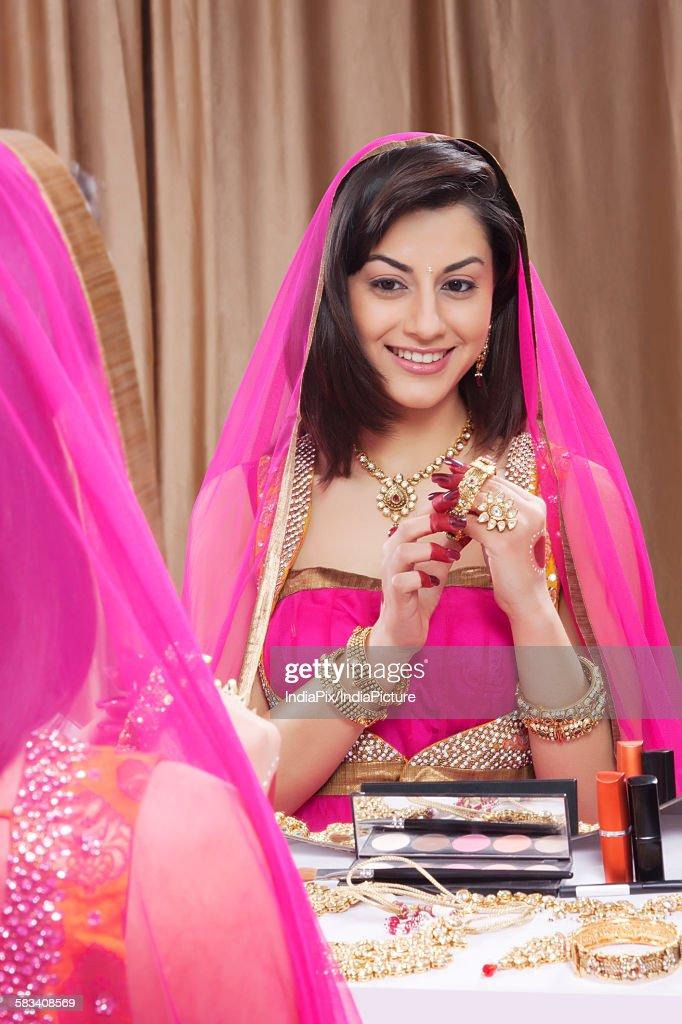 Beautiful woman wearing a bangle : Stock Photo