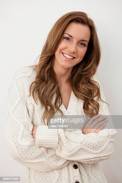 beautiful woman wearing a big baggy cardigan jumper - 縄編み ストックフォトと画像