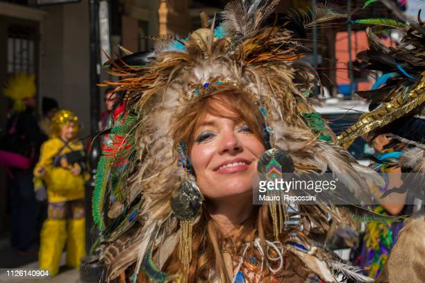 beautiful woman wearing a costume in the street during the mardi gras celebration at new orleans carnival, louisiana, usa. - mardi gras fun in new orleans stock photos and pictures