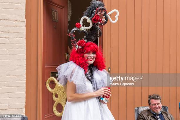 beautiful woman wearing a costume in the street during the mardi gras celebration at new orleans carnival, louisiana, usa. - creole ethnicity stock pictures, royalty-free photos & images