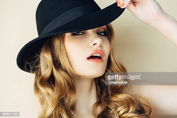 Beautiful woman wearing black hat