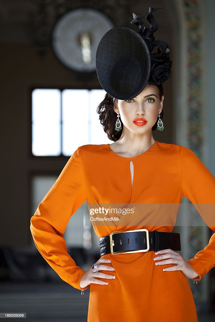 Beautiful woman wearing clothes and accessories haute couture : Stock Photo