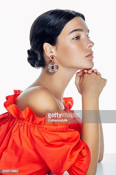 beautiful woman wearing clothes and jewelry haute couture - orange dress stock pictures, royalty-free photos & images