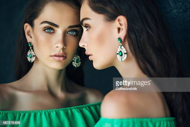 beautiful woman wearing cocktail dress - green dress stock pictures, royalty-free photos & images