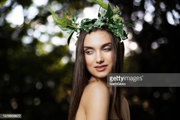 beautiful woman wearing crown made from plant at forest - mystic goddess stock photos and pictures