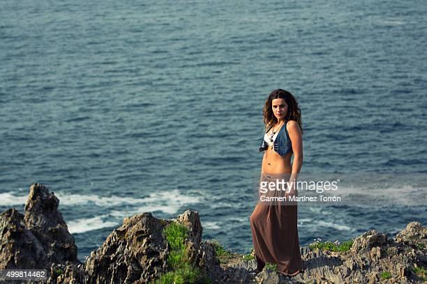 beautiful woman wearing denim vest. side view. - carmen bella foto e immagini stock