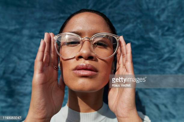 beautiful woman wearing eyeglasses - occhiali da vista foto e immagini stock