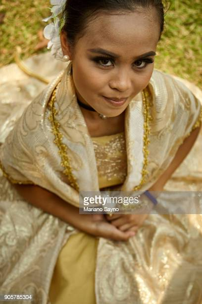 beautiful woman wearing festival costume - filipino culture stock photos and pictures