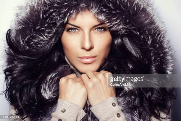 beautiful woman wearing fur hood - fur hat stock photos and pictures