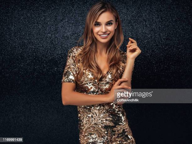 beautiful woman wearing golden dress - evening gown stock pictures, royalty-free photos & images