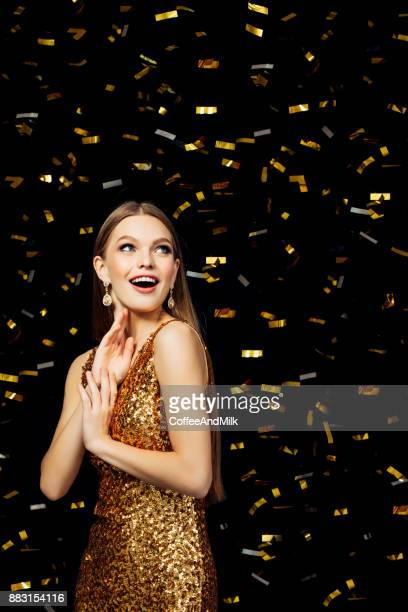 beautiful woman wearing golden dress - gold dress stock pictures, royalty-free photos & images