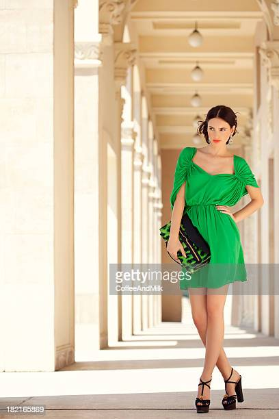 Beautiful woman wearing green dress