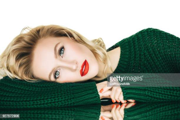 beautiful woman wearing green sweater - red lipstick stock pictures, royalty-free photos & images