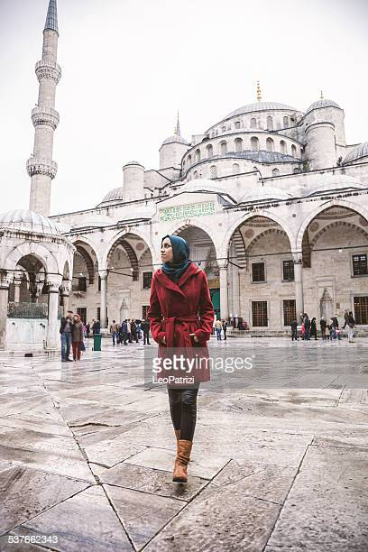 beautiful woman wearing headscarf - blue mosque stock pictures, royalty-free photos & images