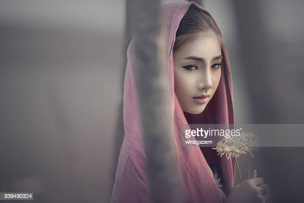 beautiful woman wearing her traditional dress. - wiratgasem stock photos and pictures
