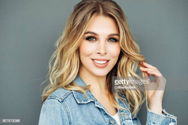 beautiful woman wearing jeans jacket - pretty blondes stock pictures, royalty-free photos & images