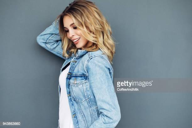 Beautiful woman wearing jeans jacket
