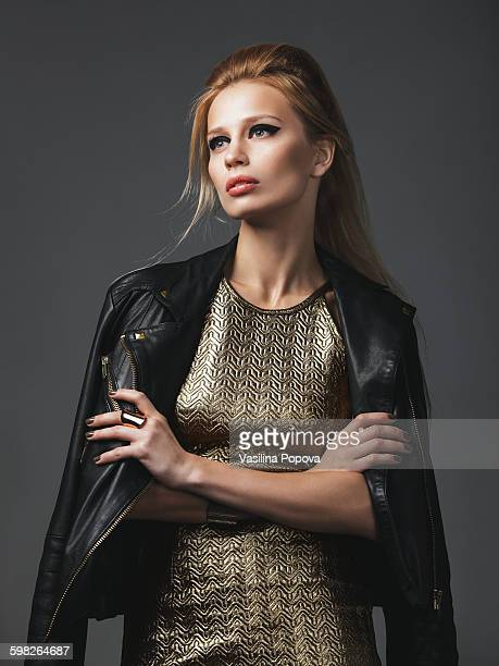 beautiful woman wearing leather jacket - metallic dress stock pictures, royalty-free photos & images