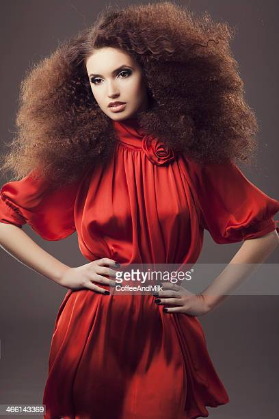 beautiful woman wearing luxurious red dress - high fashion stock pictures, royalty-free photos & images