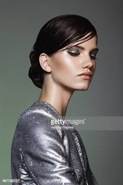 Beautiful woman wearing sequin jacket