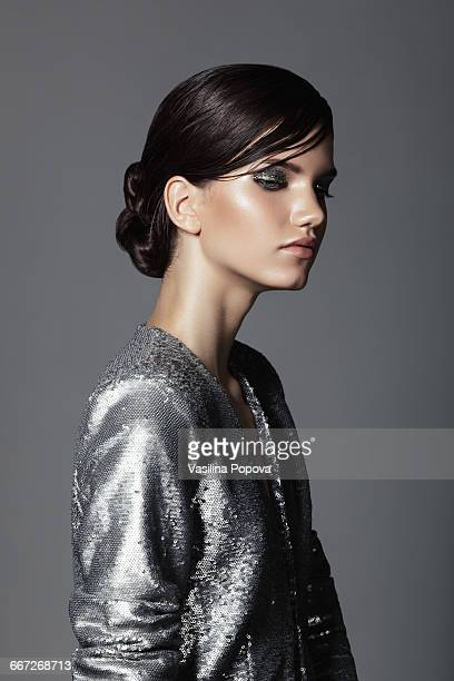 beautiful woman wearing sequin jacket - gray coat stock pictures, royalty-free photos & images