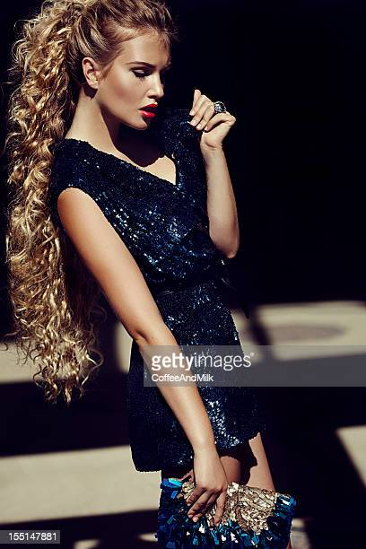 beautiful woman wearing shiny dress - long purse stock photos and pictures