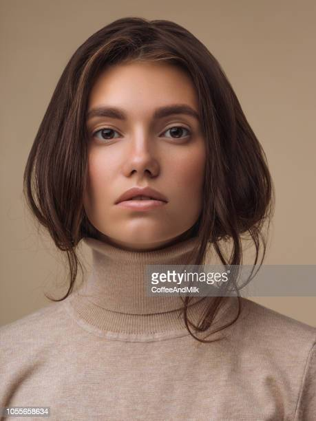 beautiful woman wearing sweater - brown hair stock pictures, royalty-free photos & images