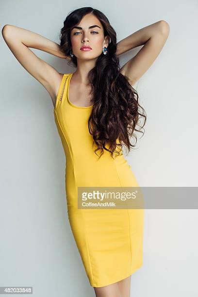 Beautiful woman wearing yellow dress
