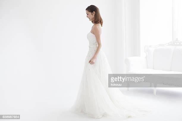 Beautiful woman wears a wedding dress.
