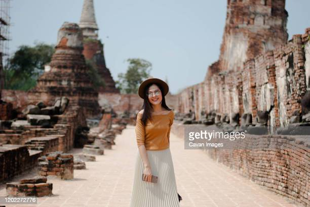 beautiful woman who is on holiday in ayutthaya, thailand - ayuthaya province stock pictures, royalty-free photos & images